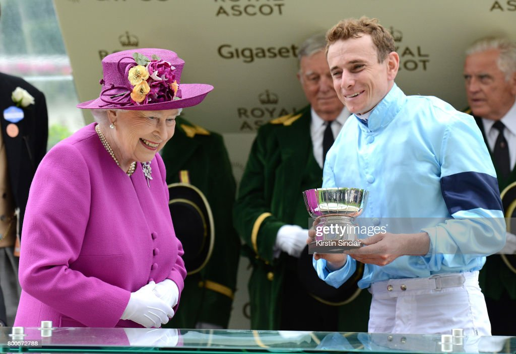 Queen Elizabeth II presents the Global Sprint Challenge Cup to Ryan Moore on day 5 of Royal Ascot 2017 at Ascot Racecourse on June 24, 2017 in Ascot, England.