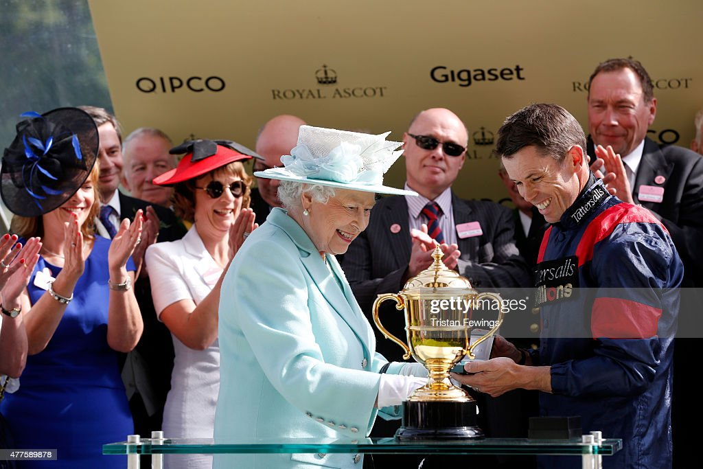Queen Elizabeth II presents the Gold Cup to winner Graham Lee during day 3 of Royal Ascot 2015 at Ascot racecourse on June 18 2015 in Ascot England
