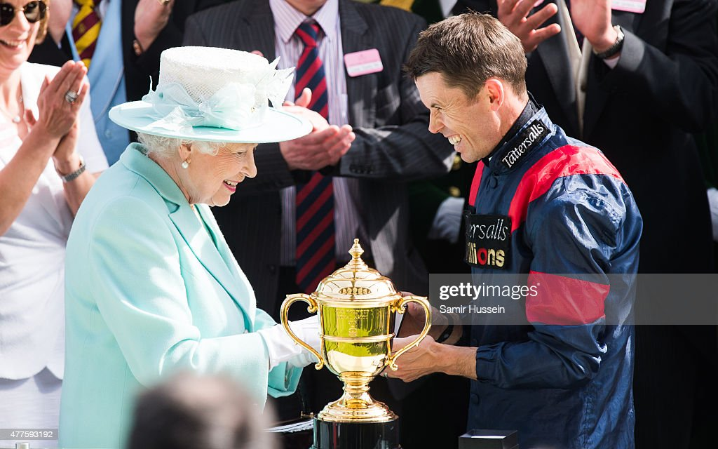 Queen Elizabeth II presents the Gold Cup to wnning jockey Graham Lee as she attends Ladies Day on day 3 of Royal Ascot at Ascot Racecourse on June 18...