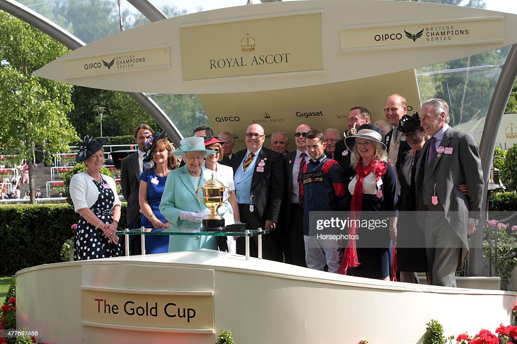 Queen Elizabeth II presents the Gold Cup trophy to Graham Lee on Ladies Day at Royal Ascot Racecourse on June 18 2015 in Ascot England