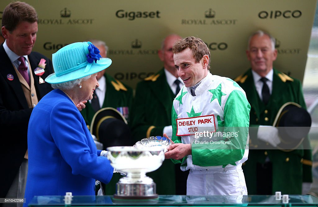 Queen Elizabeth II presents the Leading Jockeys Trophy to Ryan Moore on day 5 of Royal Ascot at Ascot Racecourse on June 18, 2016 in Ascot, England.