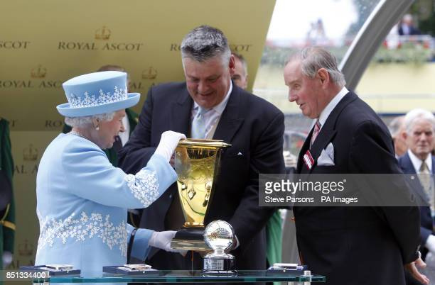 Queen Elizabeth II presents the owner of Lethal Force which was ridden by Adam Kirby after it wins the Diamond Jubilee Stakes during day five of the...