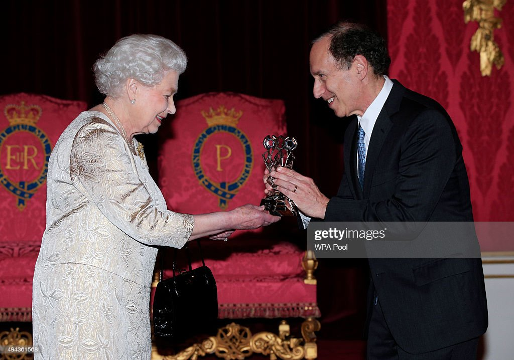 Queen Elizabeth II presents The Queen Elizabeth Prize for Engineering to Dr Robert Langer during a reception in the Throne Room at Buckingham Palace on October 26, 2015 in London, England. The Queen has presented a £1 million engineering prize to Dr Robert Langer at a reception at Buckingham Palace.