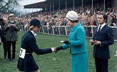 Queen Elizabeth II presents the thirdplace award to Mrs CM Parker during the Badminton Horse Trials in Gloucestershire on 16th April 1972