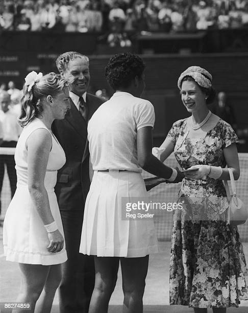 Queen Elizabeth II presents the trophy to American tennis player Althea Gibson after she won the Women's Singles final at Wimbledon 6th July 1957 On...