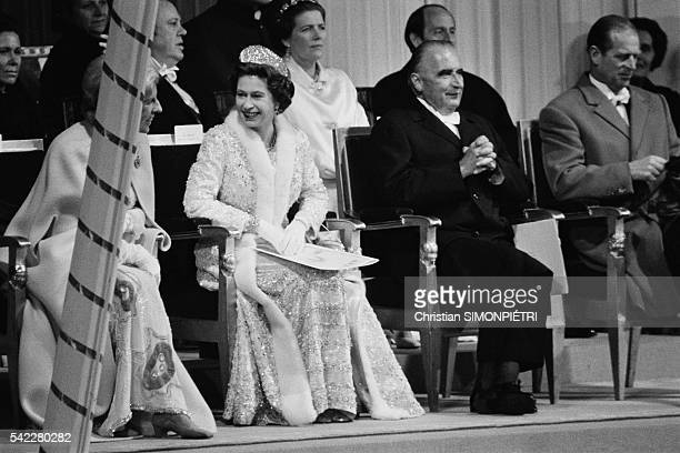 Queen Elizabeth II President Georges Pompidou and his wife Claude Cahour attend a gala organized by the Cadre Noir at the National School of...