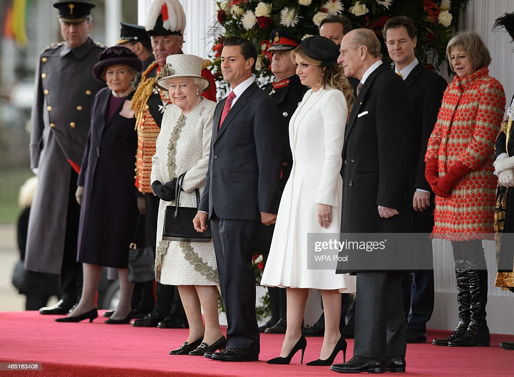 Queen Elizabeth II, President of Mexico Enrique Pena Nieto and his wife Angelica Rivera, and Prince Philip (R) prepare to listen to the national anthem during a Ceremonial Welcome at Horse Guards Parade on March 3, 2015 in London, England. The President of Mexico, accompanied by Senora Angelica Rivera de Pena, are on a State Visit to the United Kingdom as the guests of Her Majesty The Queen from Tuesday 3rd March to Thursday 5th March.