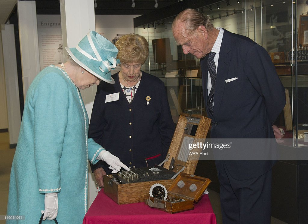 Queen <a gi-track='captionPersonalityLinkClicked' href=/galleries/search?phrase=Elizabeth+II&family=editorial&specificpeople=67226 ng-click='$event.stopPropagation()'>Elizabeth II</a> presses the button to start the enigma code breaking machine as <a gi-track='captionPersonalityLinkClicked' href=/galleries/search?phrase=Prince+Philip&family=editorial&specificpeople=92394 ng-click='$event.stopPropagation()'>Prince Philip</a>, Duke of Edinburgh and wartime operator Ruth Bourne look on during a visit to Bletchley Park on July 15, 2011 in Milton Keynes, England. Bletchley Park is the historic site of secret British code-breaking activities during WWII.