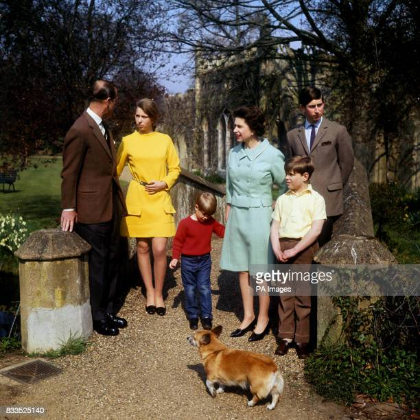 Queen Elizabeth II Prince Charles Prince Edward Prince Andrew and Princess Anne listening to the Duke of Edinburgh on a bridge in the grounds of...