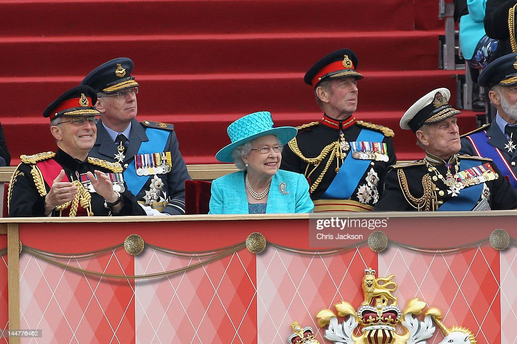 Queen <a gi-track='captionPersonalityLinkClicked' href=/galleries/search?phrase=Elizabeth+II&family=editorial&specificpeople=67226 ng-click='$event.stopPropagation()'>Elizabeth II</a>, Prince Philip, Duke of Edinburgh (R) and Chief of the Defence Staff General Sir David Richards (L) watch the flypast as they attend the Armed Forces Parade and Muster on May 19, 2012 in Windsor, England. Over 2500 troops took part in the Diamond Jubilee Muster in Home Park.