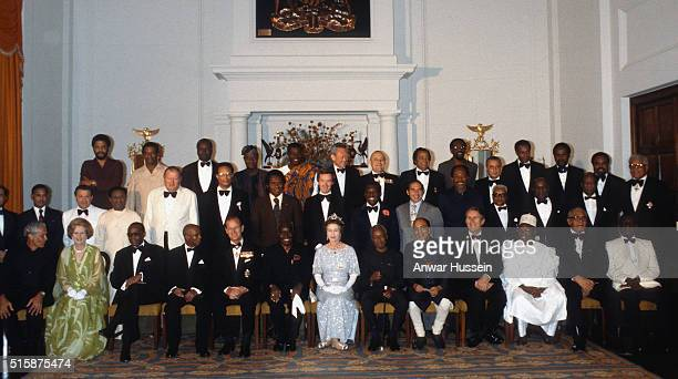 Queen Elizabeth II Prince Philip Duke of Edinburgh and Prime Minister Margaret Thatcher pose with Commonwealth heads of government before attending a...