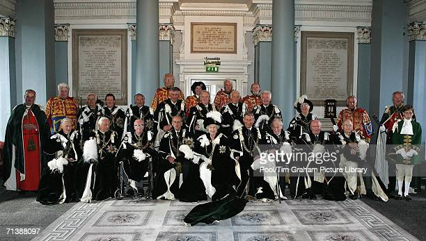 Queen Elizabeth II Prince Philip Duke of Edinburgh and Prince Charles Prince of Wales with Knights of the Thistle in the Signet Library prior to the...