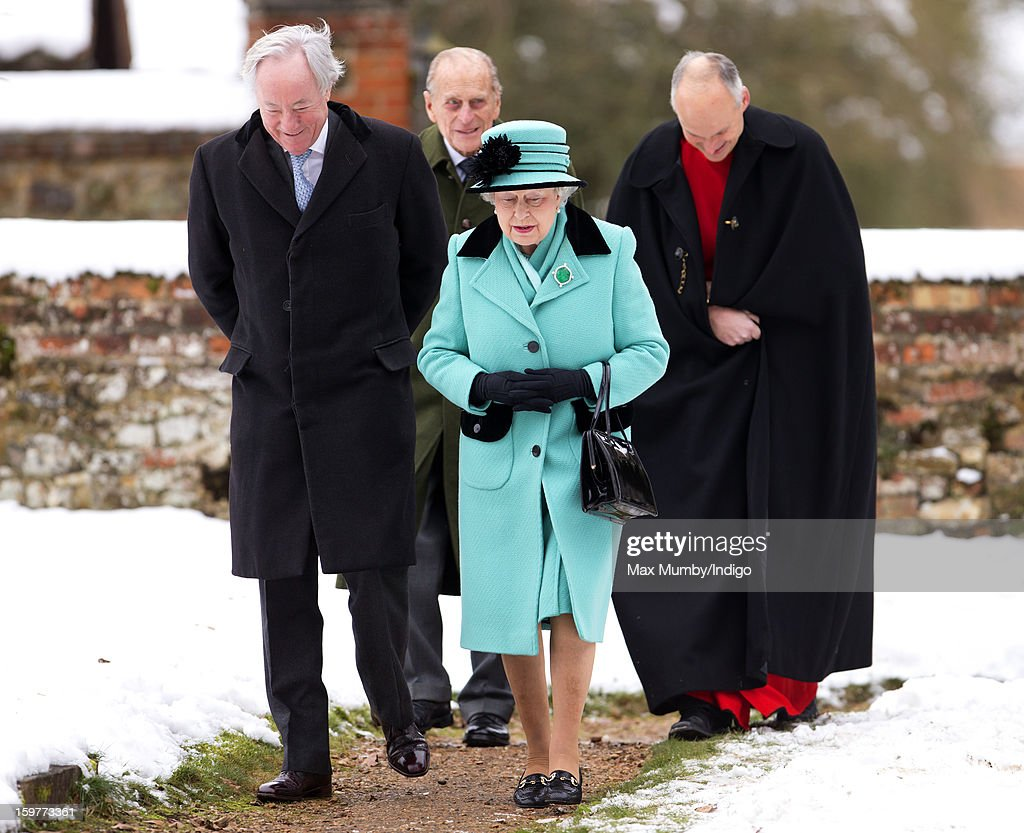 Queen Elizabeth II, Prince Philip, Duke of Edinburgh (2nd L) and Reverend Jonathan Riviere (R) walk through the snow covered church yard to attend Sunday Service at the Church of St Lawrence in Castle Rising near the Sandringham Estate on January 20, 2013 near King's Lynn, England.