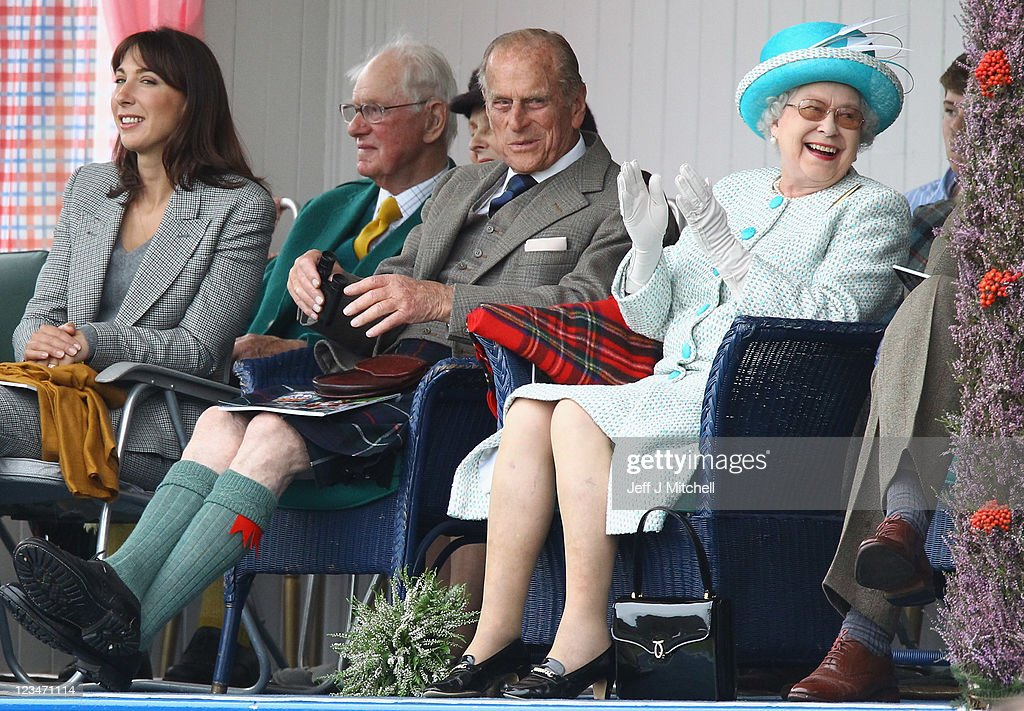 Queen Elizabeth II (R), Prince Philip, Duke of Edinburgh (2nd R) and Samantha Cameron (L) attend the Braemar Gathering of the Braemar Highland Games at The Princess Royal and Duke of Fife Memorial Park on September 3, 2011 in Braemar, Scotland. The Braemar Gathering is the most famous of the Highland Games and is known worldwide. Each year thousands of visitors descend on this small Scottish village on the first Saturday in September to watch one of the more colorful Scottish traditions. The Gathering has a long history and in its modern form it stretches back nearly 200 years.