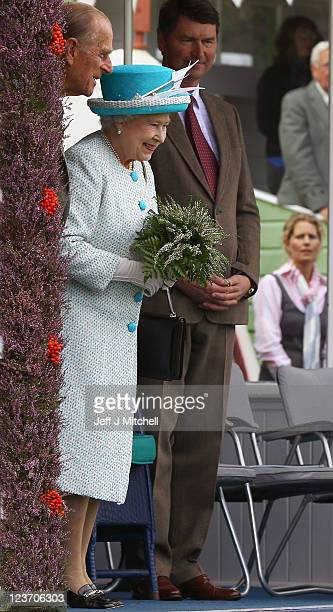 Queen Elizabeth II Prince Philip Duke of Edinburgh and Sir Timothy Laurence attend the Braemar Highland Games at The Princess Royal and Duke of Fife...