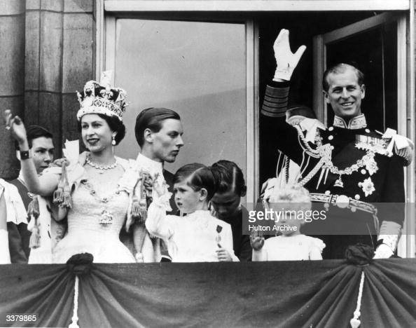 Queen Elizabeth II with Prince Philip Duke of Edinburgh and their children Prince Charles and Princess Anne wave from the balcony at Buckingham...