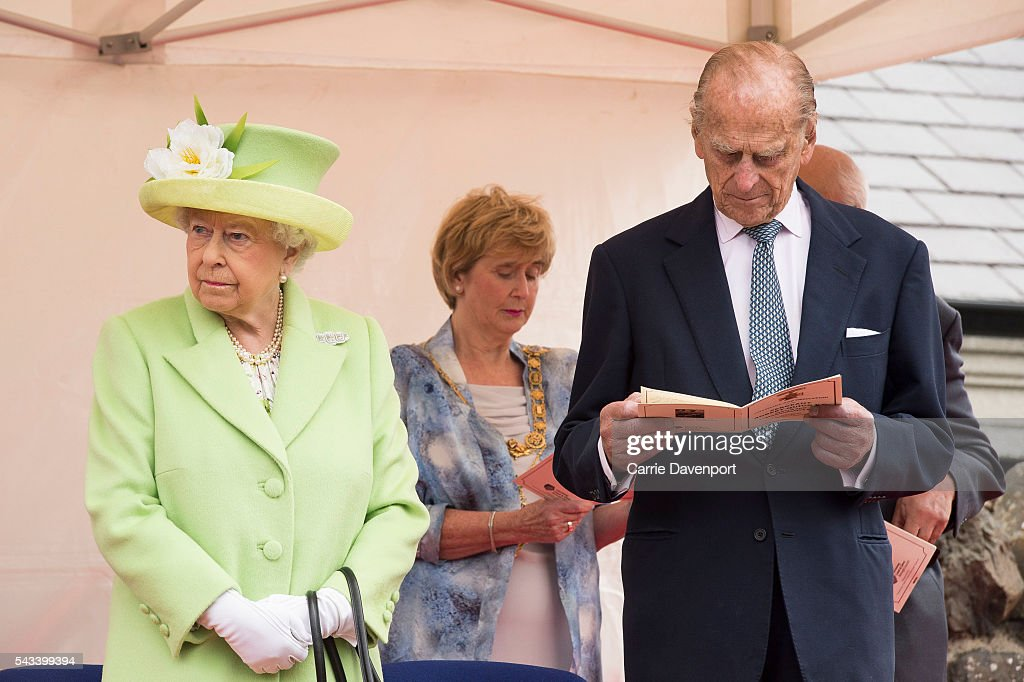 Queen <a gi-track='captionPersonalityLinkClicked' href=/galleries/search?phrase=Elizabeth+II&family=editorial&specificpeople=67226 ng-click='$event.stopPropagation()'>Elizabeth II</a> & <a gi-track='captionPersonalityLinkClicked' href=/galleries/search?phrase=Prince+Philip&family=editorial&specificpeople=92394 ng-click='$event.stopPropagation()'>Prince Philip</a>, Duke Of Edinburgh attend the unveiling of the Robert Quigg VC memorial statue in Bushmills village on June 28, 2016 in Bushmills, Northern Ireland.