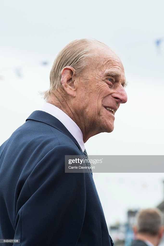 Queen Elizabeth II & <a gi-track='captionPersonalityLinkClicked' href=/galleries/search?phrase=Prince+Philip&family=editorial&specificpeople=92394 ng-click='$event.stopPropagation()'>Prince Philip</a>, Duke Of Edinburgh attend the unveiling of the Robert Quigg VC memorial statue in Bushmills village on June 28, 2016 in Bushmills, Northern Ireland.
