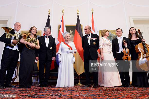 Queen Elizabeth II Prince Philip Duke of Edinburgh German President Joachim Gauck and Daniela Schadt meet the band ahead of a State Banquet on day 2...