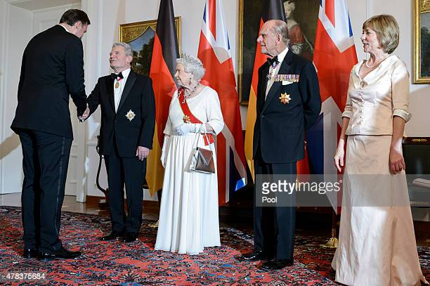 Queen Elizabeth II Prince Philip Duke of Edinburgh German President Joachim Gauck and Daniela Schadt attend a State Banquet on day 2 of a four day...