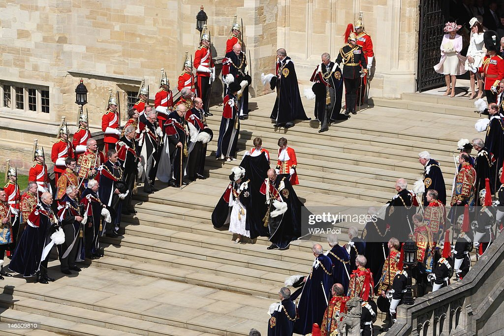 Queen <a gi-track='captionPersonalityLinkClicked' href=/galleries/search?phrase=Elizabeth+II&family=editorial&specificpeople=67226 ng-click='$event.stopPropagation()'>Elizabeth II</a>, <a gi-track='captionPersonalityLinkClicked' href=/galleries/search?phrase=Prince+Philip&family=editorial&specificpeople=92394 ng-click='$event.stopPropagation()'>Prince Philip</a>, Duke of Edinburgh leave after attending the annual Order of the Garter Service at St George's Chapel on June 18, 2011 in Windsor, England. The Order of the Garter is the senior and oldest British Order of Chivalry, founded by Edward III in 1348. Membership in the order is limited to the sovereign, the Prince of Wales, and no more than twenty-four members.