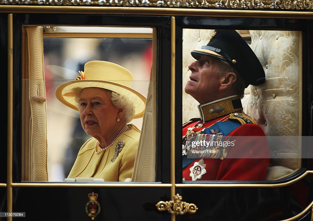 Queen <a gi-track='captionPersonalityLinkClicked' href=/galleries/search?phrase=Elizabeth+II&family=editorial&specificpeople=67226 ng-click='$event.stopPropagation()'>Elizabeth II</a> <a gi-track='captionPersonalityLinkClicked' href=/galleries/search?phrase=Prince+Philip&family=editorial&specificpeople=92394 ng-click='$event.stopPropagation()'>Prince Philip</a>, Duke of Edinburgh ride in a carriage procession to Buckingham Palace following the marriage of Their Royal Highnesses Prince William Duke of Cambridge and Catherine Duchess of Cambridge at Westminster Abbey on April 29, 2011 in London, England. The marriage of the second in line to the British throne was led by the Archbishop of Canterbury and was attended by 1900 guests, including foreign Royal family members and heads of state. Thousands of well-wishers from around the world have also flocked to London to witness the spectacle and pageantry of the Royal Wedding.