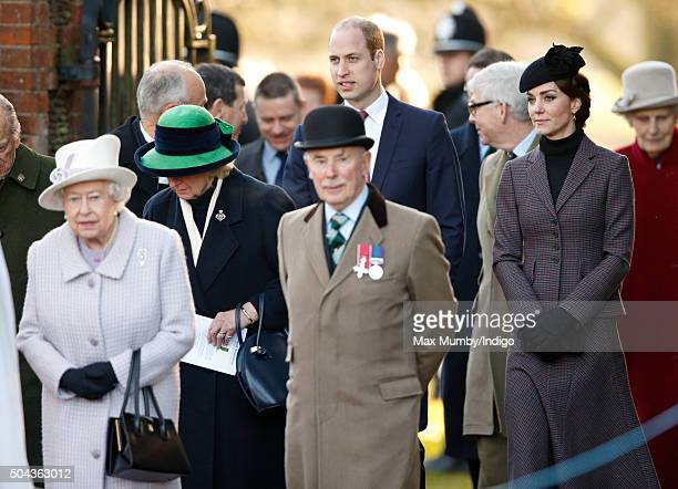 Queen Elizabeth II Prince William Duke of Cambridge and Catherine Duchess of Cambridge attend a wreath laying ceremony to mark the 100th anniversary...
