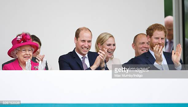 Queen Elizabeth II Prince William Duke of Cambridge Zara Phillips Mike Tindall and Prince Harry watch a carnival parade as they attend 'The Patron's...