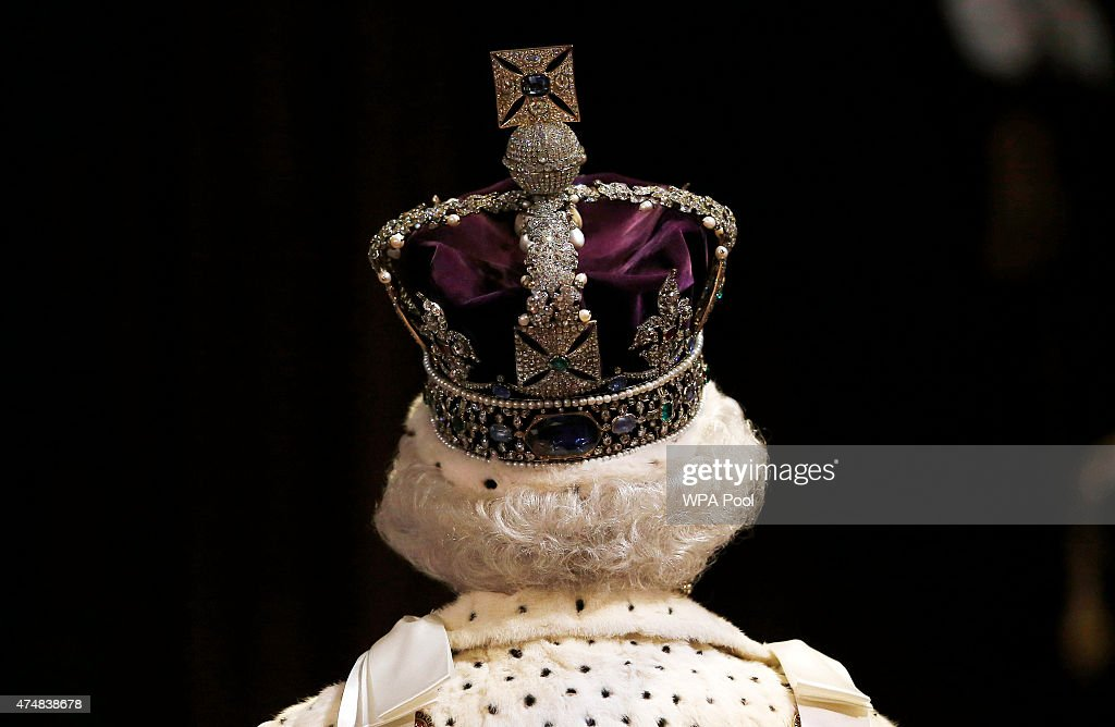 Queen Elizabeth II proceeds through the Royal Gallery before the State Opening of Parliament in the House of Lords at the Palace of Westminster on...