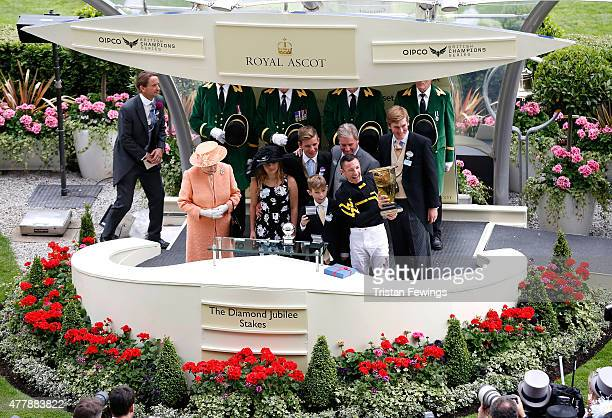 Queen Elizabeth II prsents the Diamond Jubilee Stakes with winning jockey Frankie Dettori and trainer of Undrafted Wesley A Ward during day 5 of...