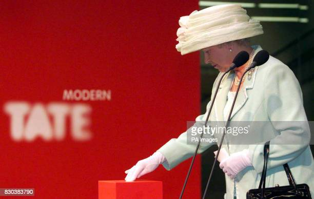 Queen Elizabeth II pushes a button as she officially opens the Tate Modern Gallery in London The former power station is destined to become one of...
