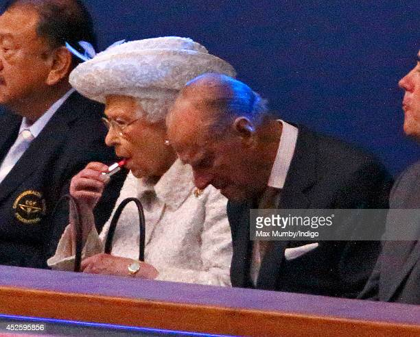 Queen Elizabeth II puts on her lip stick as she and Prince Philip Duke of Edinburgh attend the Opening Ceremony for the Glasgow 2014 Commonwealth...