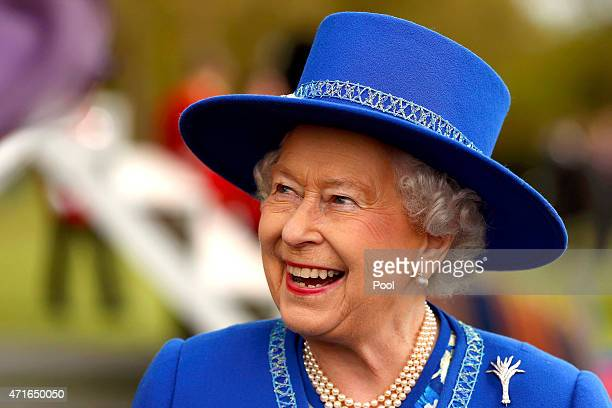 Queen Elizabeth II reacts after presenting New Colours to the 1st Battalion Welsh Guards at Windsor Castle on April 30 2015 in London United Kingdom