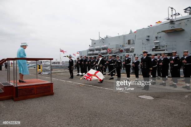 Queen Elizabeth II receives a Royal Salute from the ship's company of HMS Lancaster as she arrives at Portsmouth Naval Base for a visit to the ship...