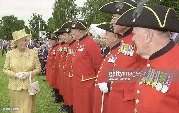 Queen Elizabeth II receives a warm welcome from Chelsea Pensioners as she visits Bushy Park during the Queen's Golden Jubilee visit to West London on...
