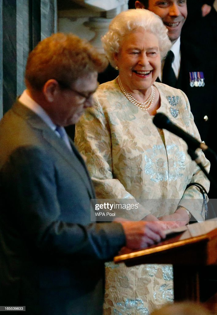 Queen <a gi-track='captionPersonalityLinkClicked' href=/galleries/search?phrase=Elizabeth+II&family=editorial&specificpeople=67226 ng-click='$event.stopPropagation()'>Elizabeth II</a> receives an honorary BAFTA from actor <a gi-track='captionPersonalityLinkClicked' href=/galleries/search?phrase=Kenneth+Branagh&family=editorial&specificpeople=213618 ng-click='$event.stopPropagation()'>Kenneth Branagh</a> in recognition of a lifetime's support to British Film and Television at Windsor Castle on April 4, 2013 in Berkshire, England.