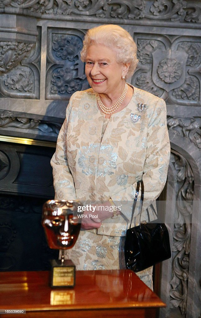 Queen Elizabeth II receives an honorary BAFTA in recognition of a lifetime's support to British Film and Television at Windsor Castle on April 4, 2013 in Berkshire, England.