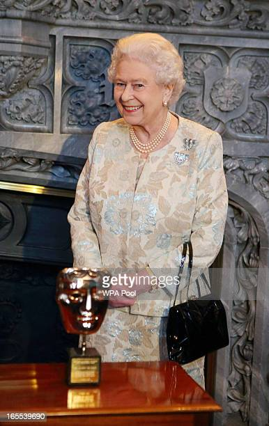 Queen Elizabeth II receives an honorary BAFTA in recognition of a lifetime's support to British Film and Television at Windsor Castle on April 4 2013...