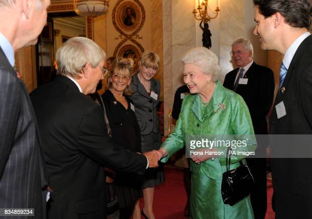 Queen Elizabeth II receives Blue Peter presenter John Noakes during a reception to mark the programme's 50th birthday at Buckingham Palace London