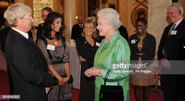 Queen Elizabeth II receives Blue Peter presenters from left to right John Noakes Konnie Huq Lesley Judd DianeLouise Jordan and Peter Purves during a...