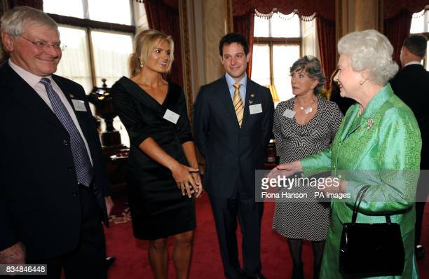 Queen Elizabeth II receives Blue Peter presenters from left to right Peter Purves Katy Hill Matt Baker and Valerie Singleton during a reception to...