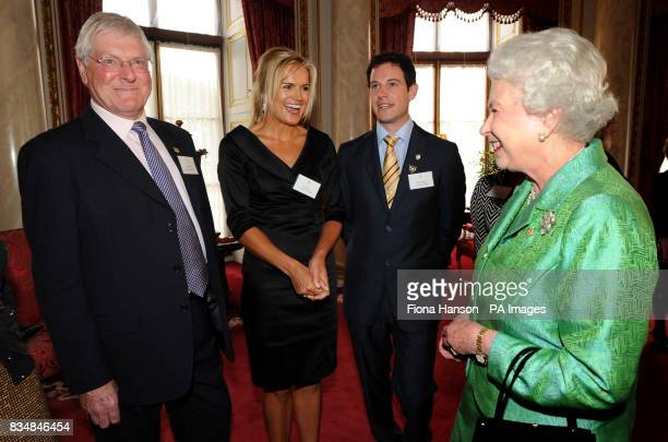 Queen Elizabeth II receives Blue Peter presenters from left to right Peter Purves Katy Hill and Matt Baker during a reception to mark the programme's...