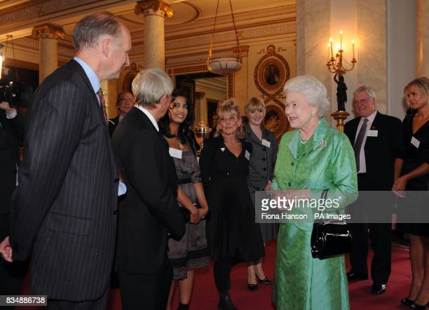 Queen Elizabeth II receives Blue Peter presenters from left to right John Noakes Konnie Huq Lesley Judd and DianeLouise Jordan during a reception to...