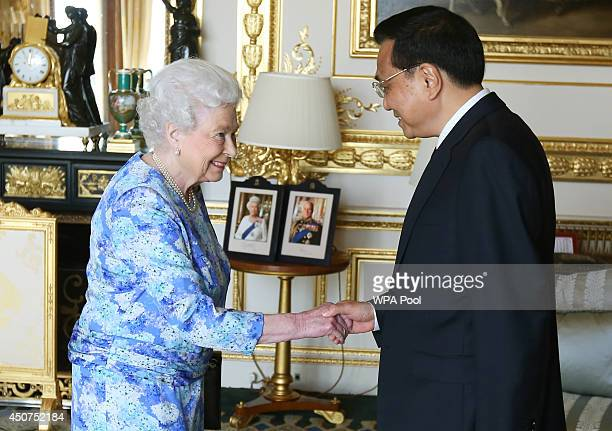 Queen Elizabeth II receives Chinese premier Li Keqiang at Windsor Castle during their visit to the UK on June 17 2014 in Windsor England During his...
