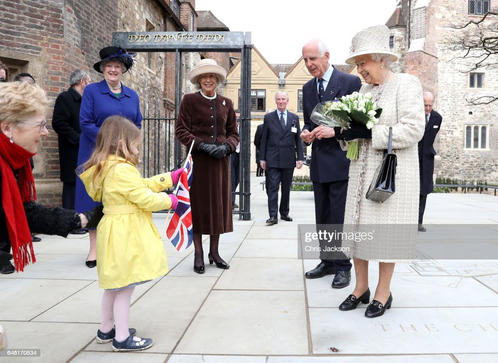 queen-elizabeth-ii-receives-flowers-from-a-child-as-she-and-prince-picture-id646170534
