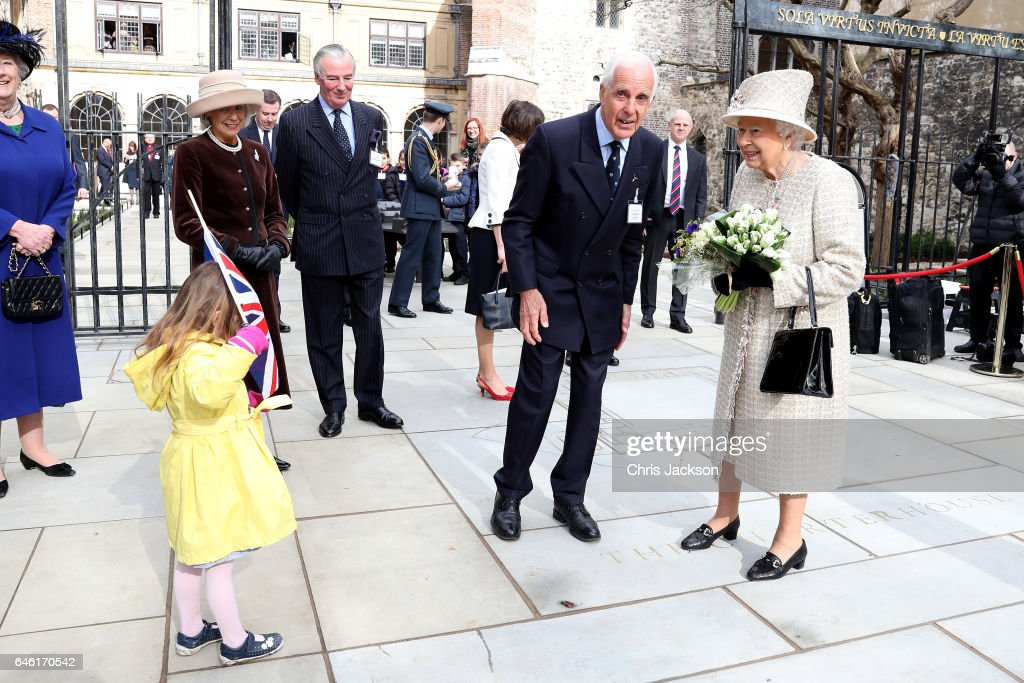 queen-elizabeth-ii-receives-flowers-from-a-child-as-she-and-prince-picture-id646170542