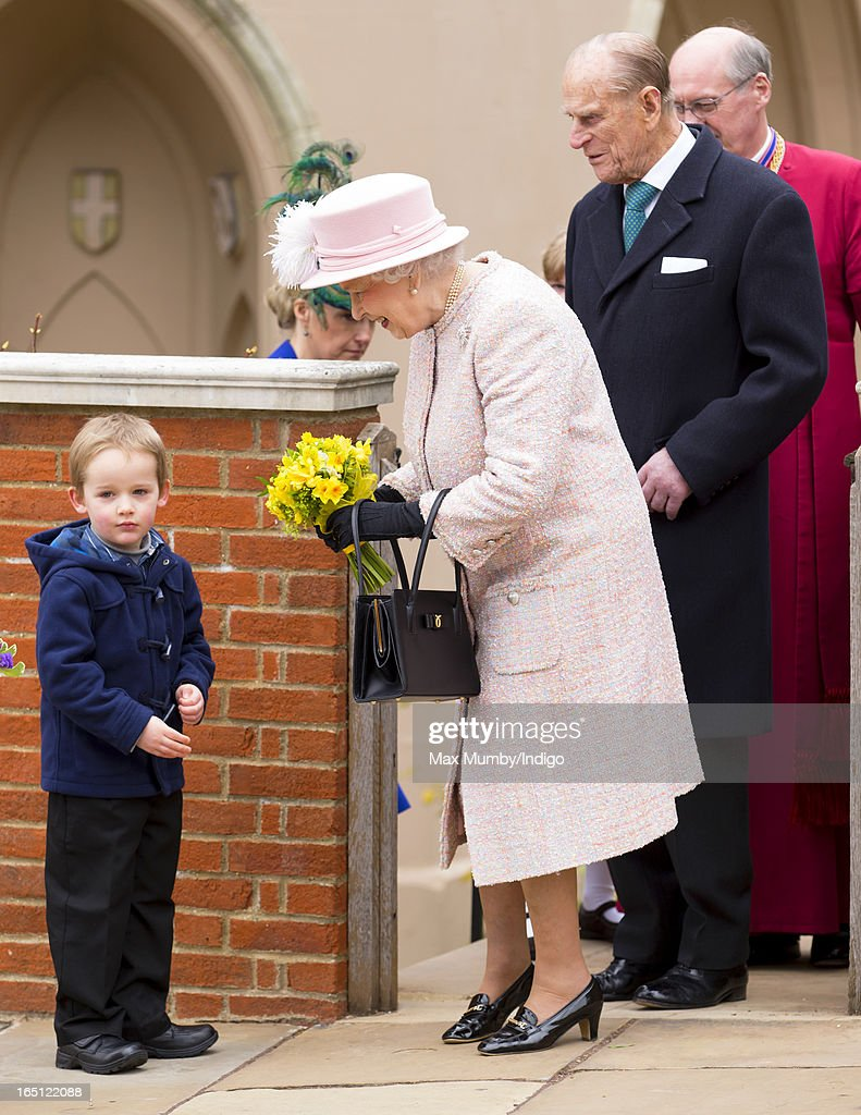 Queen <a gi-track='captionPersonalityLinkClicked' href=/galleries/search?phrase=Elizabeth+II&family=editorial&specificpeople=67226 ng-click='$event.stopPropagation()'>Elizabeth II</a> receives flowers from a young boy as she and <a gi-track='captionPersonalityLinkClicked' href=/galleries/search?phrase=Prince+Philip&family=editorial&specificpeople=92394 ng-click='$event.stopPropagation()'>Prince Philip</a>, Duke of Edinburgh attend the Easter Matins Church Service at St George's Chapel, Windsor Castle on March 31, 2013 in Windsor, England.