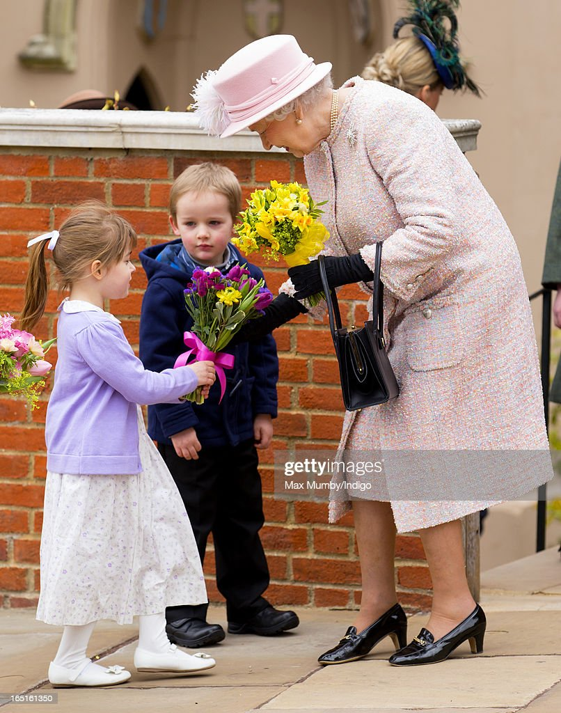 Queen <a gi-track='captionPersonalityLinkClicked' href=/galleries/search?phrase=Elizabeth+II&family=editorial&specificpeople=67226 ng-click='$event.stopPropagation()'>Elizabeth II</a> receives flowers from a young girl as she attends the Easter Matins Church Service at St George's Chapel, Windsor Castle on March 31, 2013 in Windsor, England.