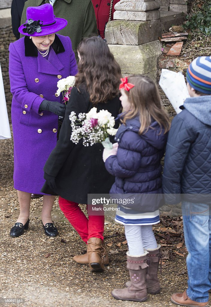 Queen Elizabeth II receives flowers from children after attending a service at the Church Of St Peter And St Paul in West Newton near Sandringhamon February 3, 2013 near King's Lynn, England.