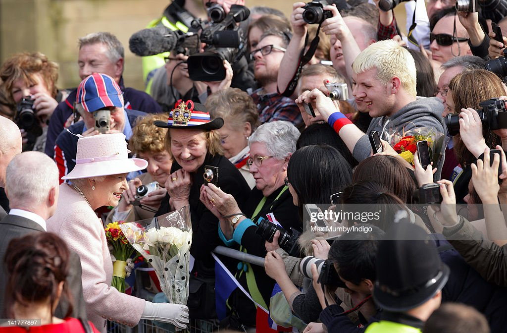 Queen <a gi-track='captionPersonalityLinkClicked' href=/galleries/search?phrase=Elizabeth+II&family=editorial&specificpeople=67226 ng-click='$event.stopPropagation()'>Elizabeth II</a> receives flowers from members of the public during a walkabout outside Manchester Town Hall on a visit to Manchester as part of her Diamond Jubilee Tour of the UK on March 23, 2012 in Manchester, England.